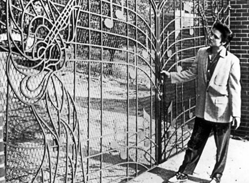 Elvis Presley poses at the new Music Gates for press photo, April 22, 1957.