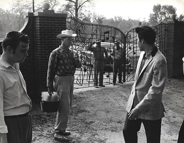 Elvis Presley with Arthur Hooten (far left) at Graceland April 22, 1957.
