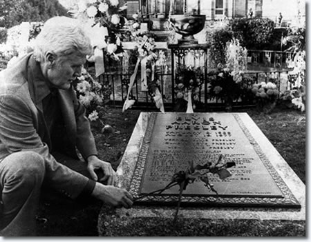 Vernon Presley at Elvis' grave at Graceland.